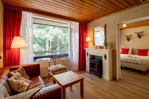Ein Sitzbereich in der Unterkunft Badhotel Rockanje
