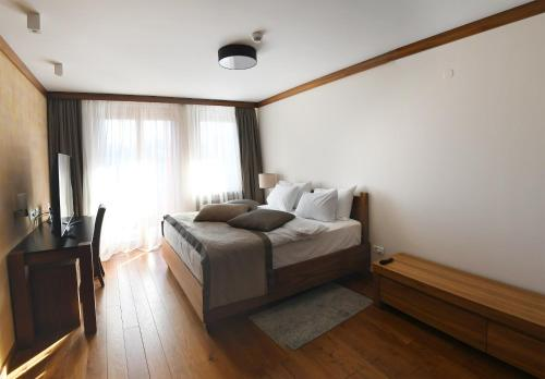 Aparthotel Vucko tesisinde bir odada yatak veya yataklar