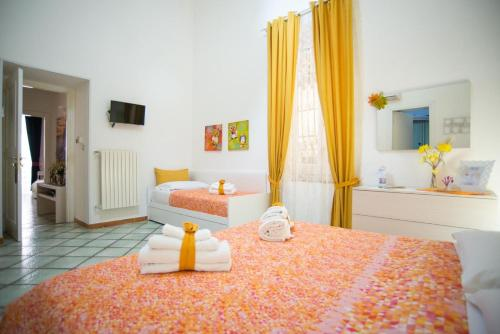 A bed or beds in a room at B&B Dei Mercanti