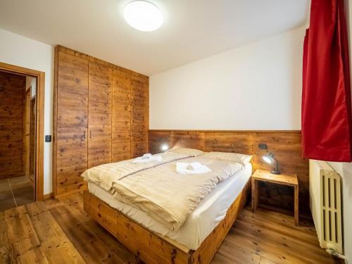 Postel nebo postele na pokoji v ubytování Apartments & Rooms MyHolidayLivigno