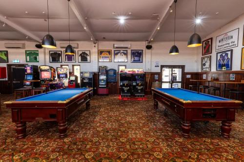 A pool table at Nightcap at Wintersun Hotel