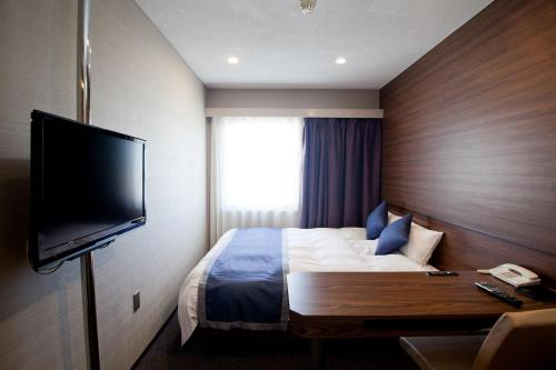 A bed or beds in a room at Hotel Il Credo Gifu