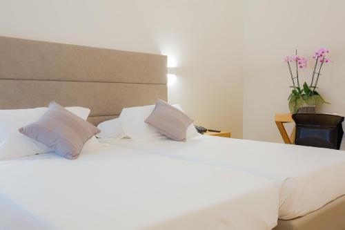 Letto o letti in una camera di Hotel Politeama