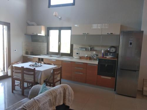 A kitchen or kitchenette at Village Loft Apartment