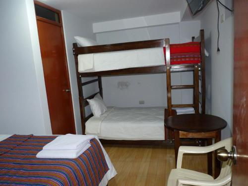 A bunk bed or bunk beds in a room at HAMAY WASI