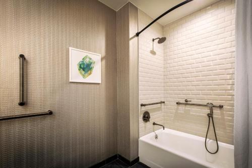 A bathroom at Kimpton Hotel Monaco Denver, an IHG Hotel