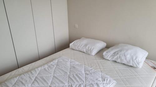 Un ou plusieurs lits dans un hébergement de l'établissement Golden Trust Apartments