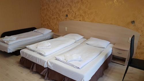 Łóżko lub łóżka w pokoju w obiekcie Apartamenty w Hotelu DIVA