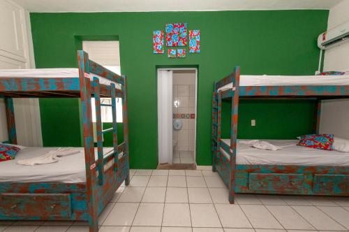 A bunk bed or bunk beds in a room at Hostel Barra