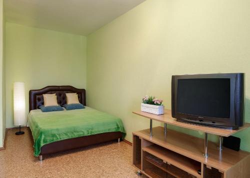 Кровать или кровати в номере Апартаменты Аврора