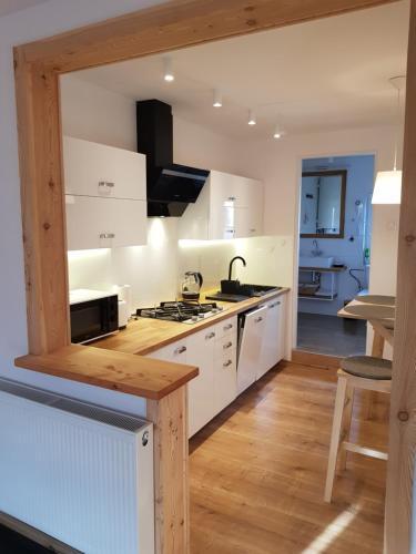 A kitchen or kitchenette at Gabi Apartament Zakopane