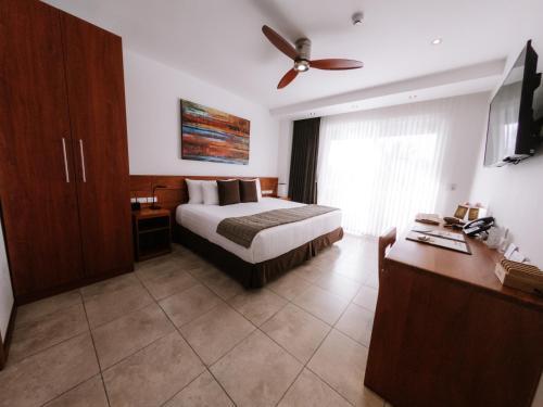 Ein Bett oder Betten in einem Zimmer der Unterkunft Hotel Cucuve