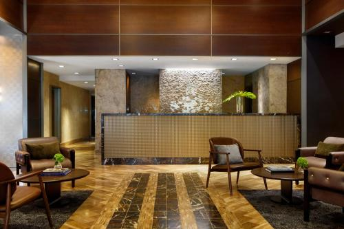 The lobby or reception area at The Kimpton Muse Hotel, an IHG Hotel
