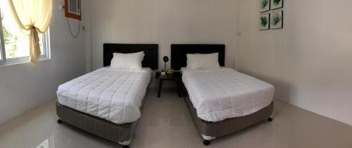A bed or beds in a room at Arriyus Apartelle