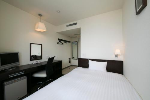 เตียงในห้องที่ Hotel A'bant Shizuoka