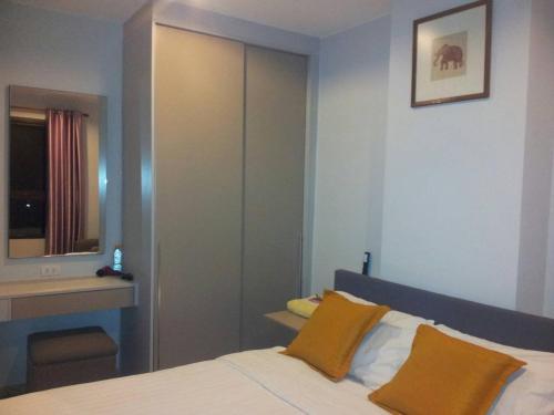 Кровать или кровати в номере Zcape Condominium Bangtao Beach