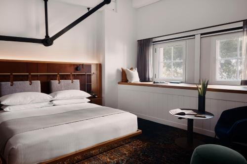 A bed or beds in a room at Pier One Sydney Harbour, Autograph Collection