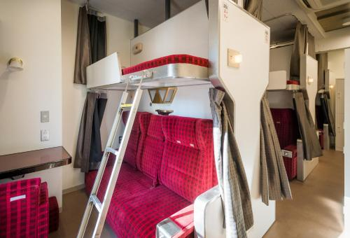 A bunk bed or bunk beds in a room at Train Hostel HOKUTOSEI