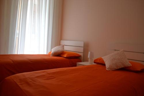 A bed or beds in a room at GARDENIA