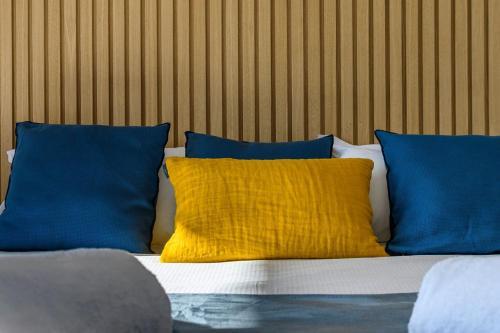Un ou plusieurs lits dans un hébergement de l'établissement Calarossa Bay Resort
