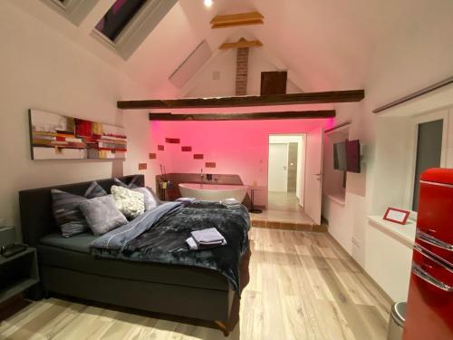 Ein Bett oder Betten in einem Zimmer der Unterkunft Auszeit Vienna Wellness Apartment