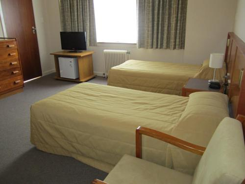 A bed or beds in a room at University House - ANU