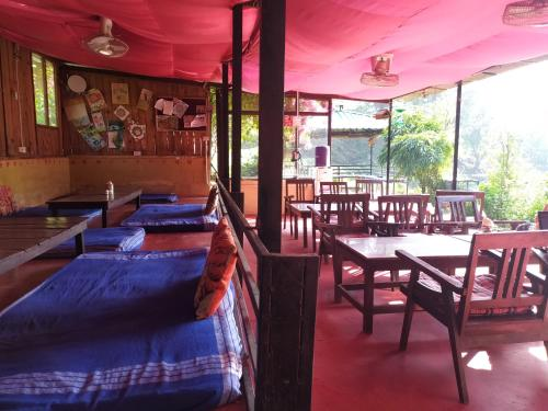 A restaurant or other place to eat at Rishikesh Valley