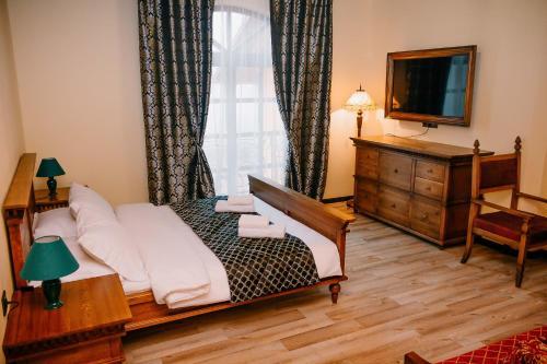 Кровать или кровати в номере АгроУсадьба VILLA-HOTEL