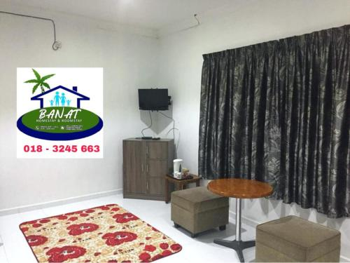 A television and/or entertainment center at BANAT Homestay & Roomstay Arau