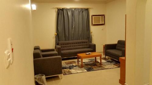 Uma área de estar em شقق جنة الوادي الفندقية