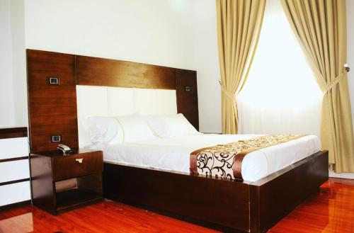 A bed or beds in a room at Afro legacy hotel