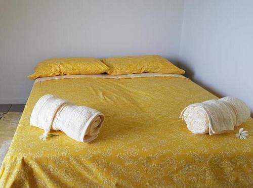 Cama ou camas em um quarto em Le Tiki Rouge