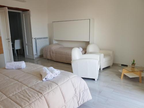 A bed or beds in a room at AL TEATRO VERDI LUXURY APARTMENT