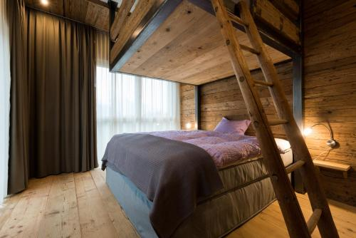A bed or beds in a room at WOO® Loft Resort