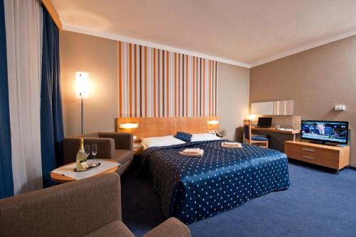 A bed or beds in a room at Hotel Blue Bratislava