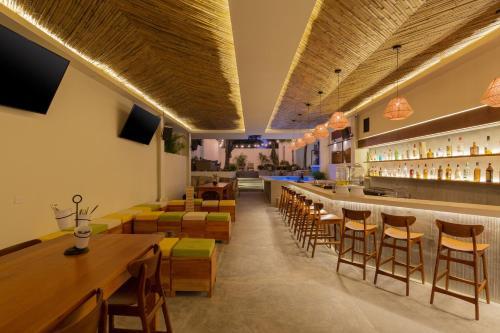 Restaurant ou autre lieu de restauration dans l'établissement oOstel Smart Hostel - Tulum Pueblo