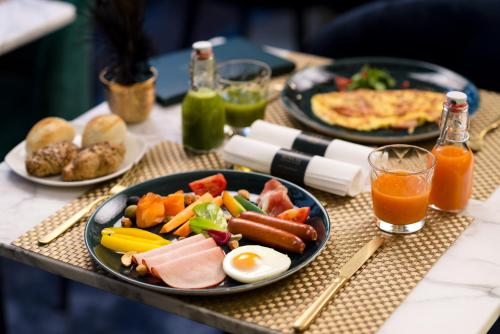 Breakfast options available to guests at Hotel Moments Budapest