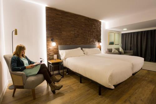 Cama o camas de una habitación en Centric Atiram Hotel