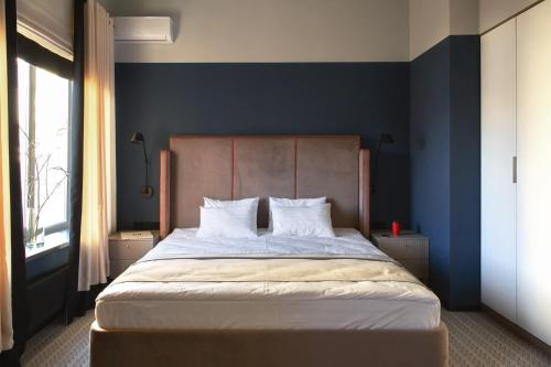Кровать или кровати в номере Отель Рязань