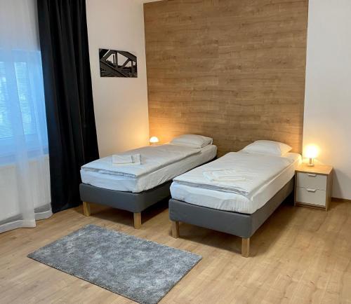 Postel nebo postele na pokoji v ubytování Frýdecká Apartments