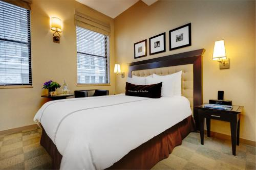 A bed or beds in a room at Library Hotel by Library Hotel Collection