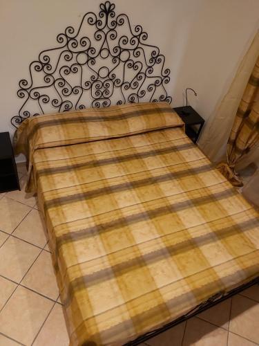 A bed or beds in a room at La Casa di Pina