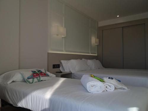 A bed or beds in a room at Oca Playa de Foz Hotel&Spa