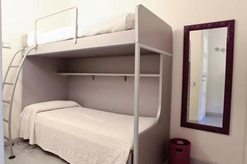 A bunk bed or bunk beds in a room at Condominio Dunelba