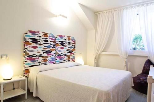 A bed or beds in a room at Condominio Dunelba