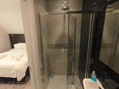 A bathroom at Debden Guest House
