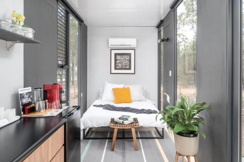 A bed or beds in a room at Tiny House 888