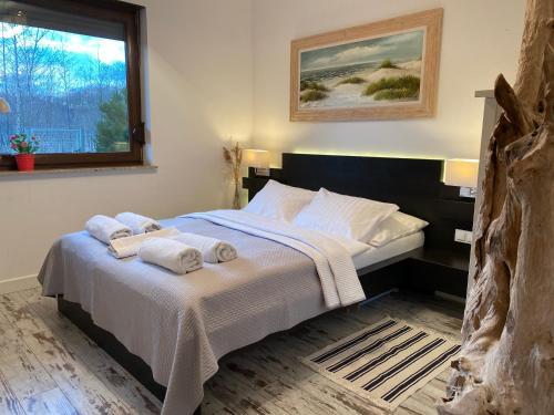 Łóżko lub łóżka w pokoju w obiekcie Apartamenty Nad Morzem