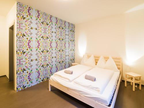 Postel nebo postele na pokoji v ubytování Hostel Zahrada Mikulov