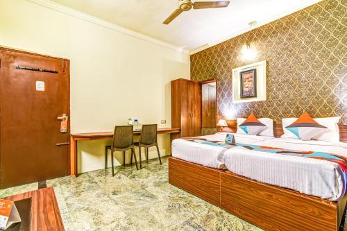 Кровать или кровати в номере FabExpress Nestlay Rooms